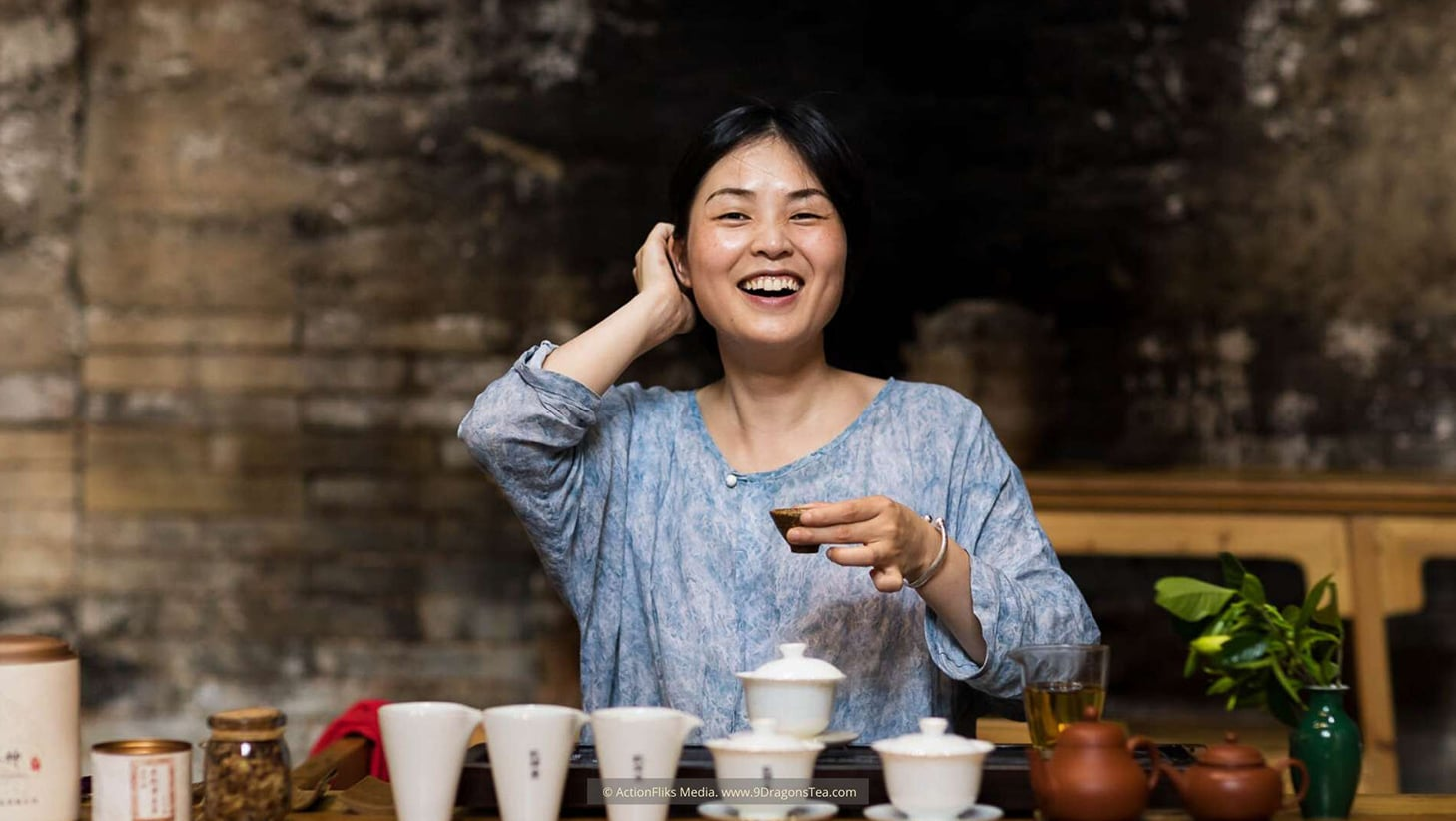 Wuyishan culture Chinese tea rituals tea tasting lady holding a cup smiling happy tea drinking