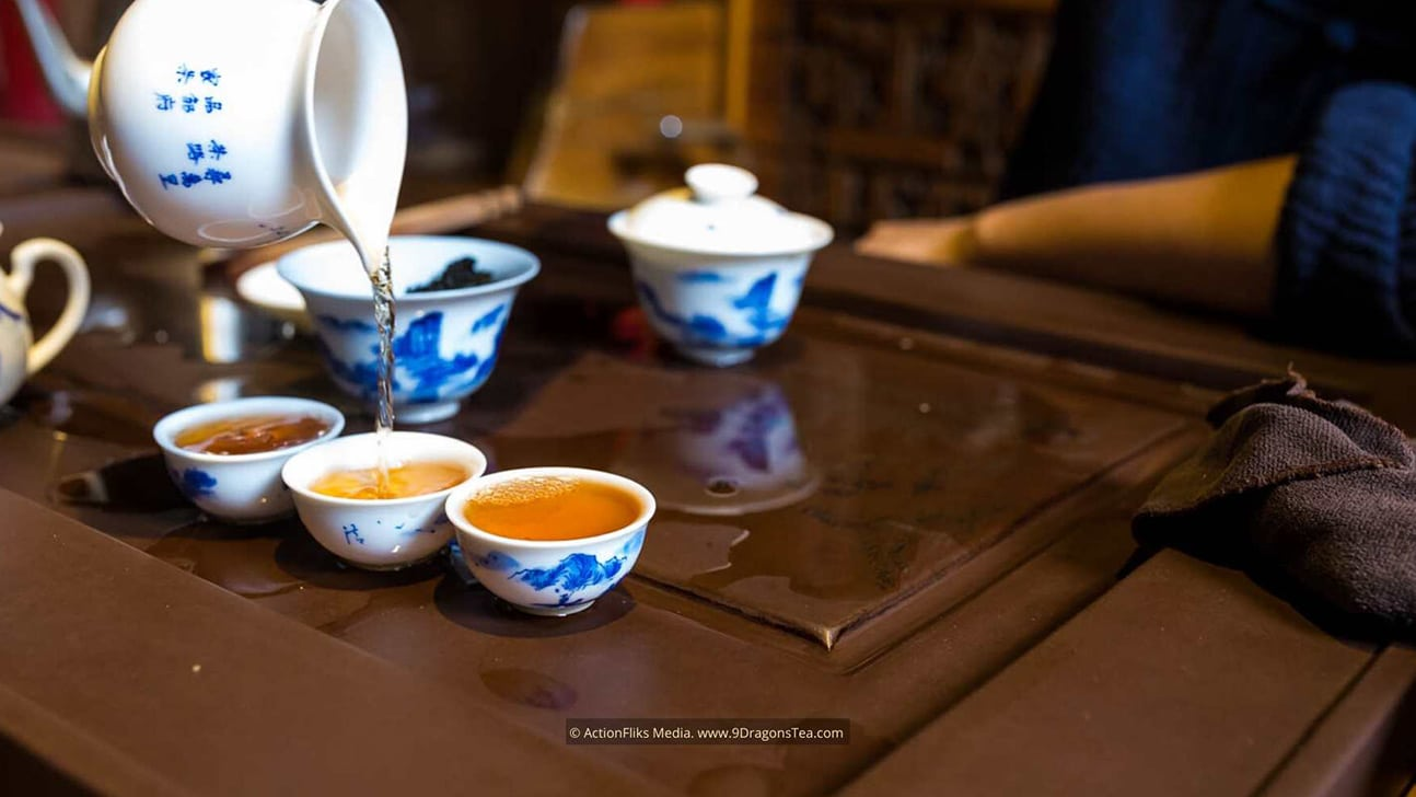 chinese tea rituals Gong Fu Cha ceremony tea tasting pouring oolong tea into cups