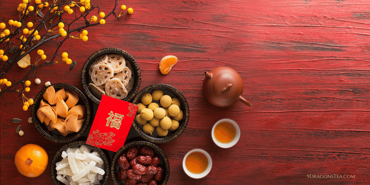 9 dragons tea chinese new year lai see red pocket with teapot-tea-fortune cookies-tangerines
