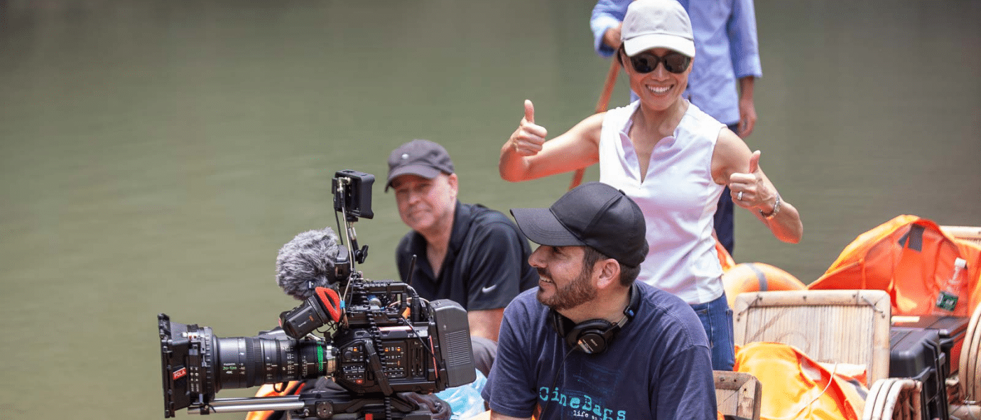 christy hui directing on a river scene