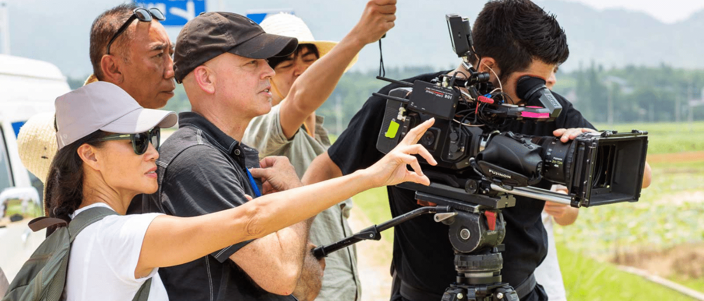 christy hui directing on location with camera crew