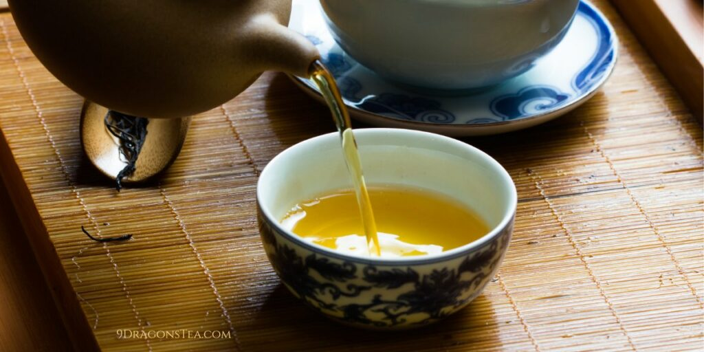 green tea pouring into chinese teacup