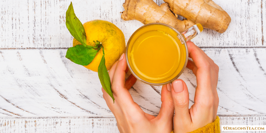 Ginger Tea Health Benefits-a cup of Ginger tea with lemon held in hand