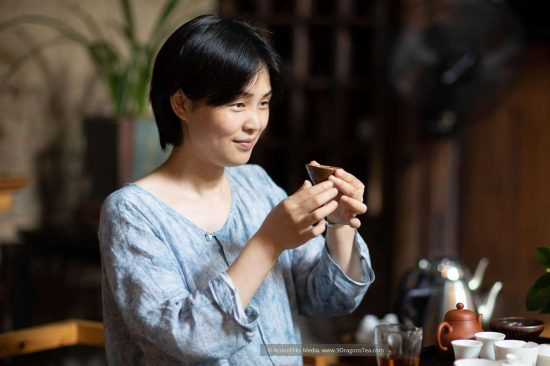 Wuyishan culture Chinese tea rituals gong fu cha tea tasting Duer Zhang a lady holding a cup with tea set teacups teapot