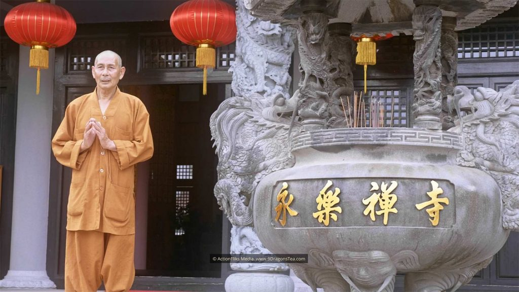 chinese tea history wuyishan culture Buddhist Monk Standing In Front of Mother Temple