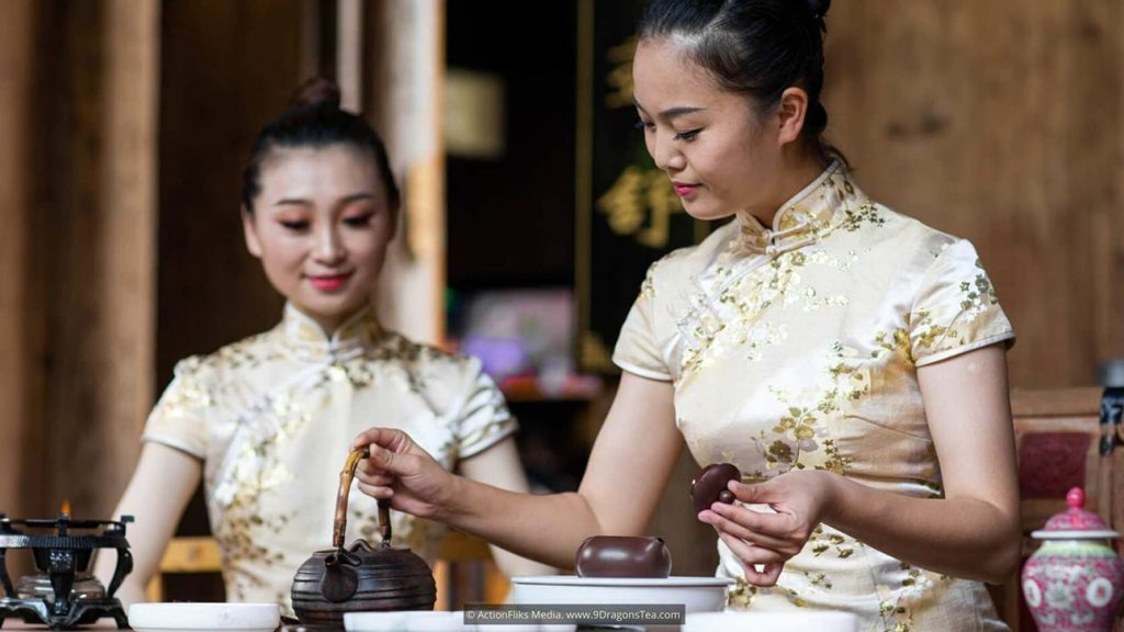 two girls brewing tea traditional way