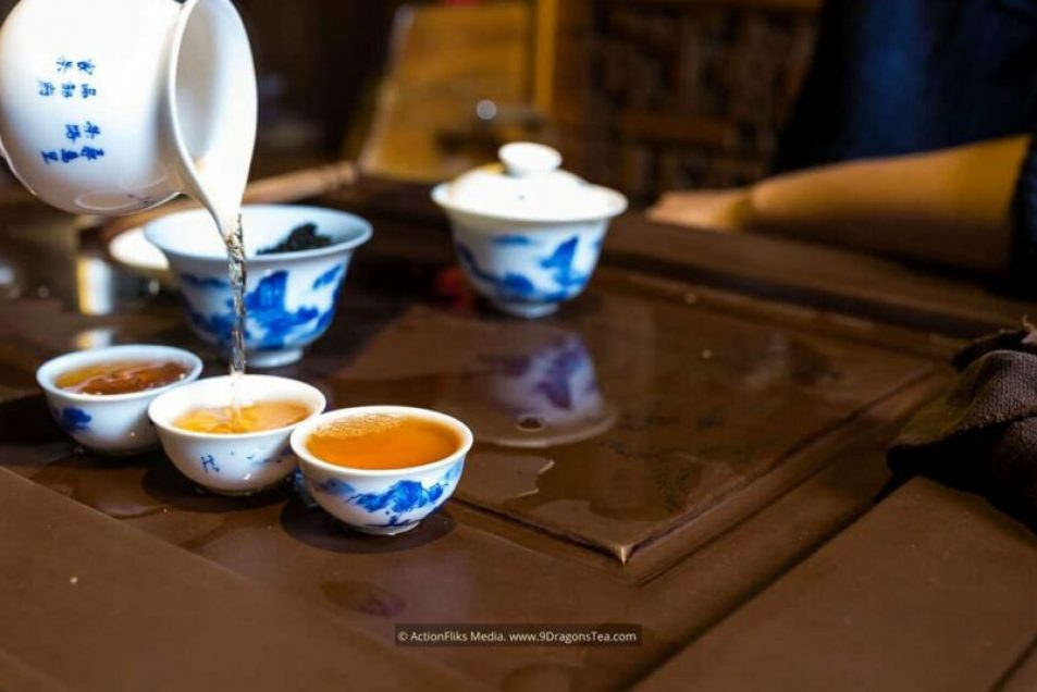 chinese tea Gong Fu Cha ceremony tea tasting pouring oolong tea into cups